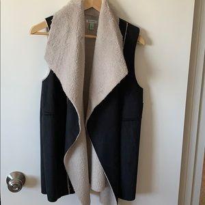 Black suede vest with white faux fur underneath